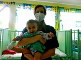 Featured Travel Photo - ANA: I had to wear a mask so I wouldn't spread any germs to the babies
