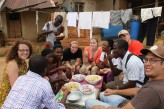 Featured Travel Photo - villagers treated HEPENS to a traditional Ghanian lunch after an outreach. Eating with your left hand is considered to be very rude